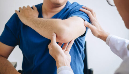 man with elbow injury