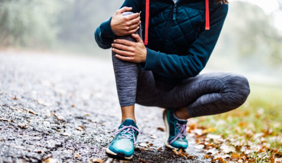 athletic woman holding leg